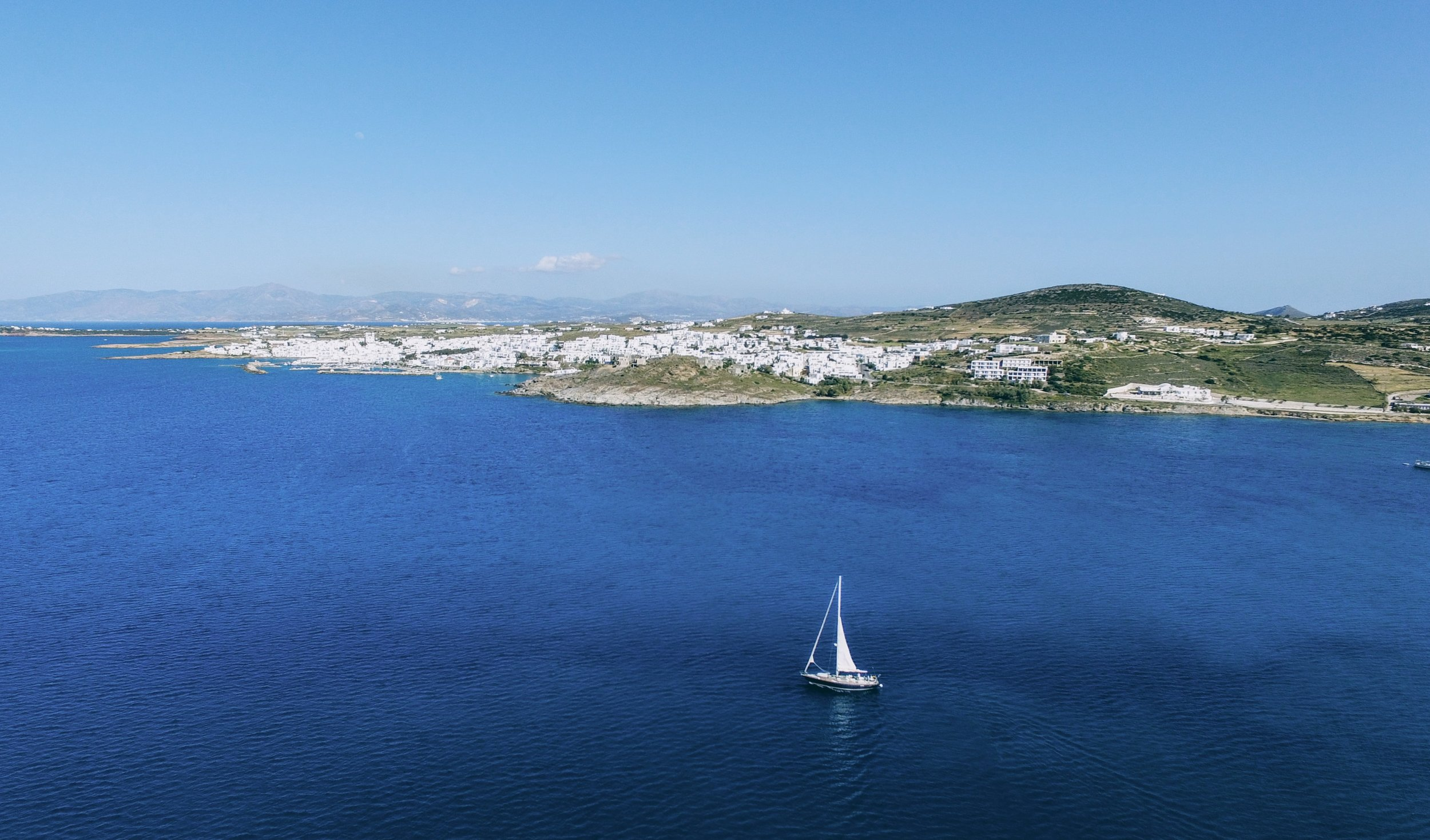 The Weekly Getaway: white-washed houses, blue-domed churches and golden sand in Paros