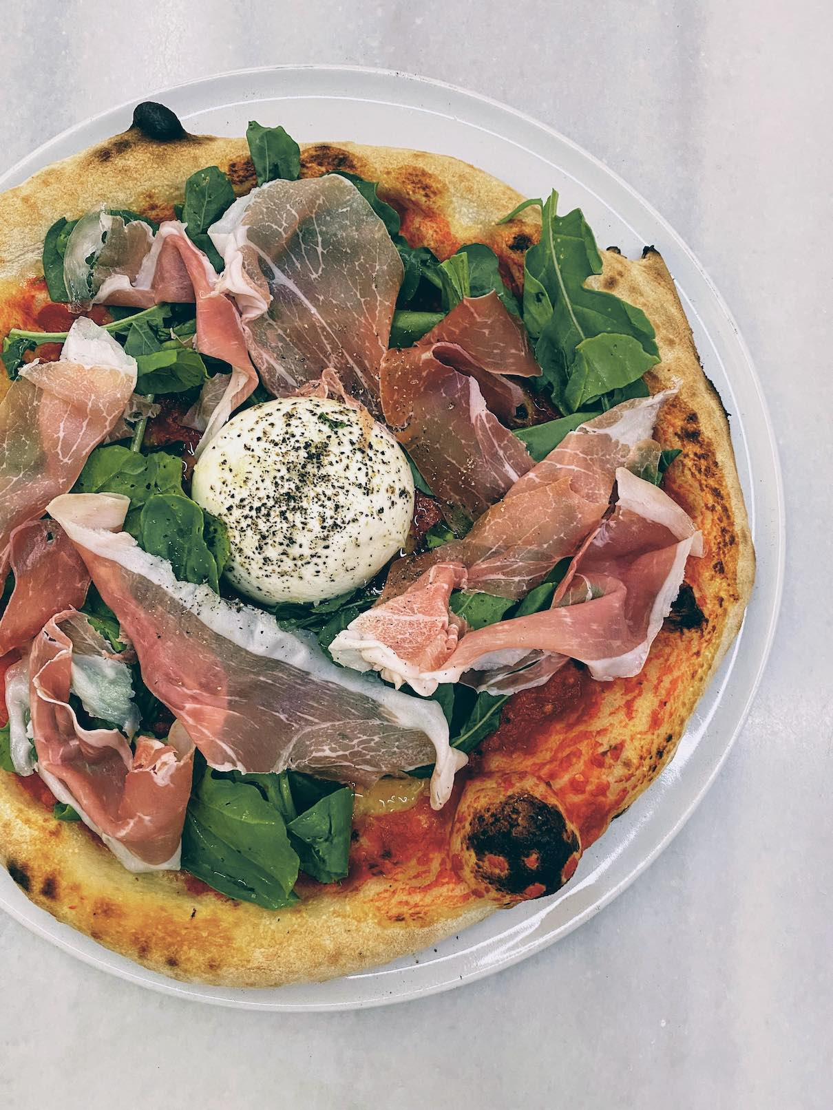 Kythira: eclectic Italian pizza with a stunning sunset view at Tony's